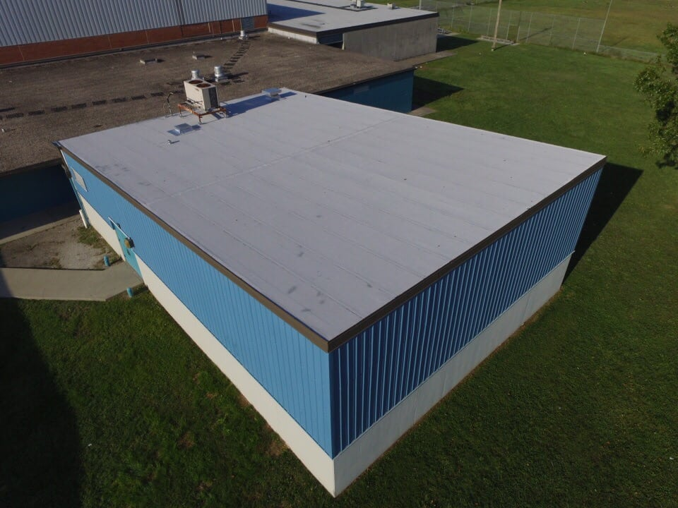 Grey Roof on Small Commercial Building completed by Bowling Roofing.