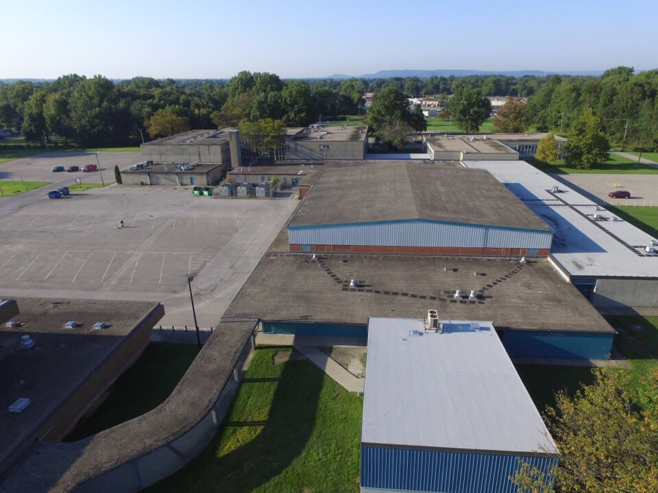 Aerial view of a black commercial roof completed by Bowling Roofing.