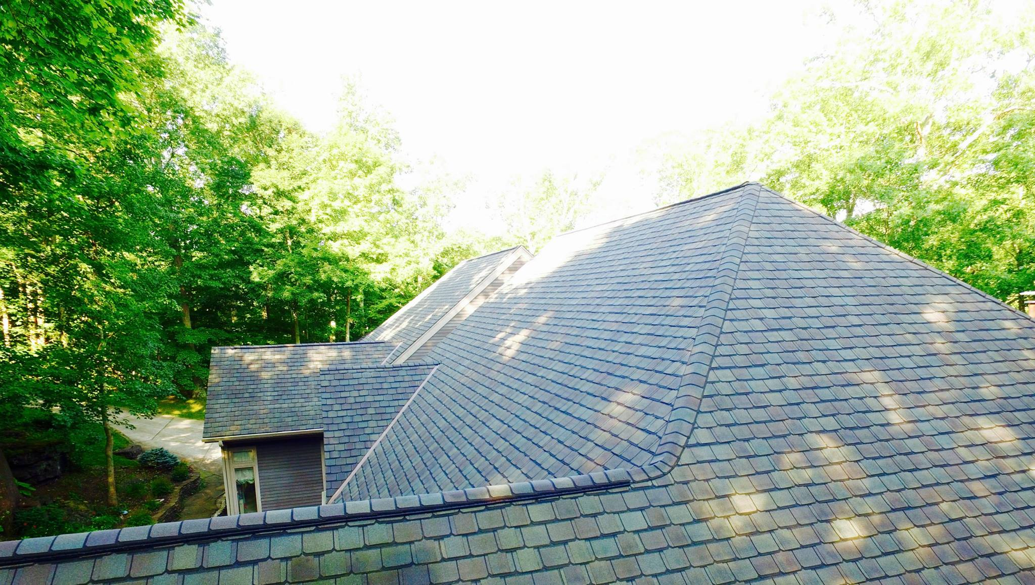 New grey shingles applied to residential property completed by Bowling Roofing.