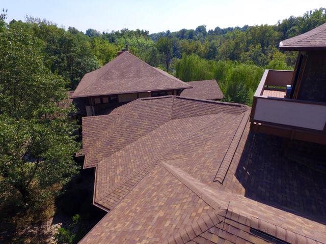 New brown shingled roof on a sunny day completed by Bowling Roofing.