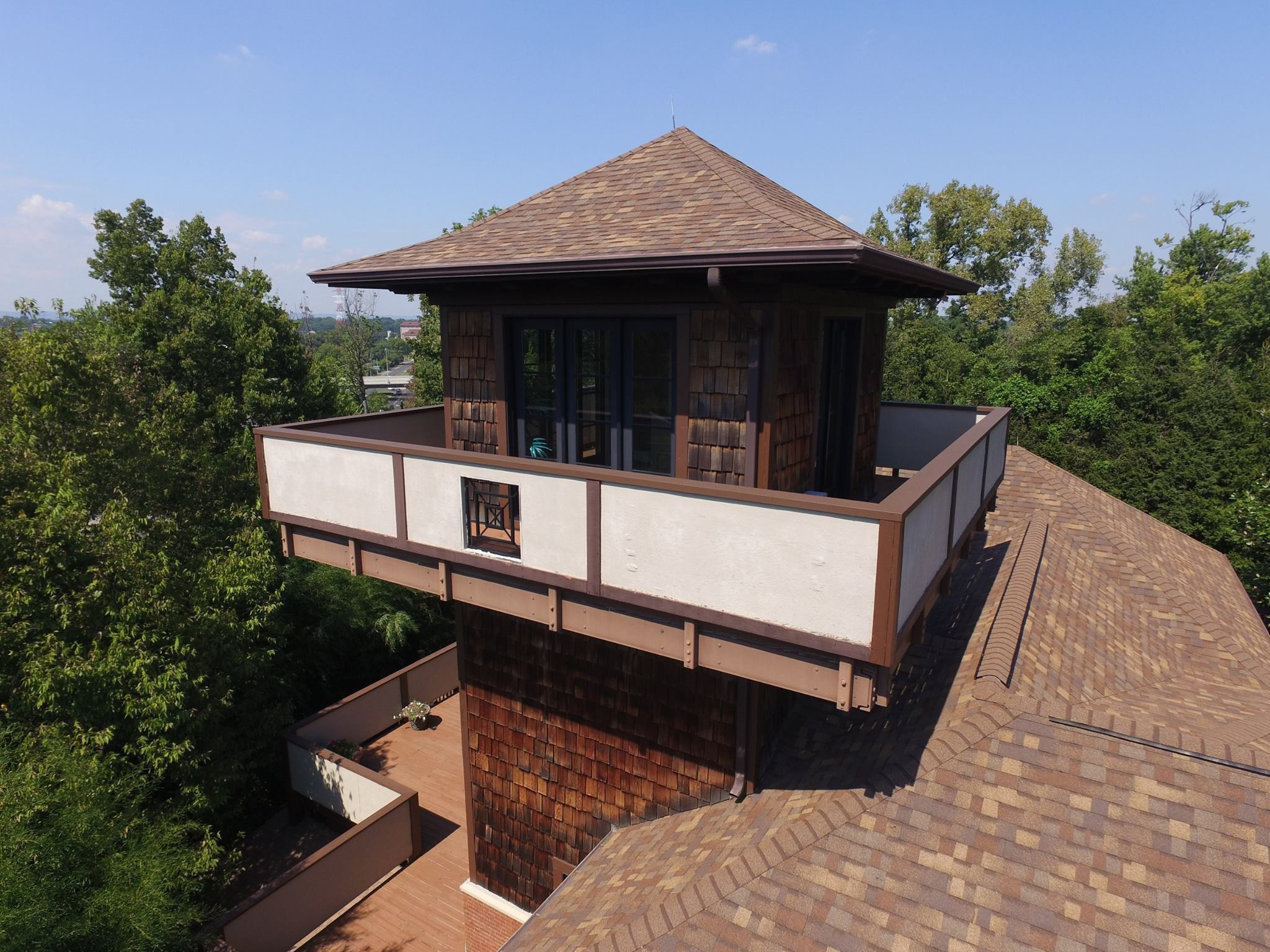 New brown roof showcasing an amazing overwatch completed by Bowling Roofing.