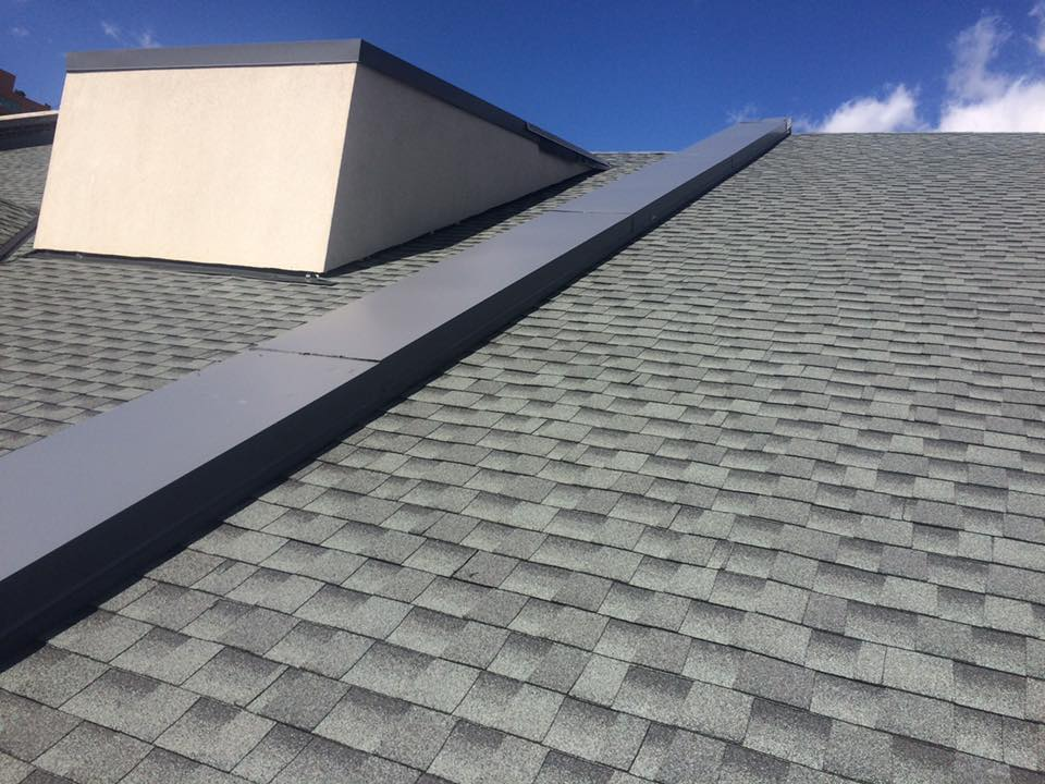 New roof with grey shingles completed by Bowling Roofing.