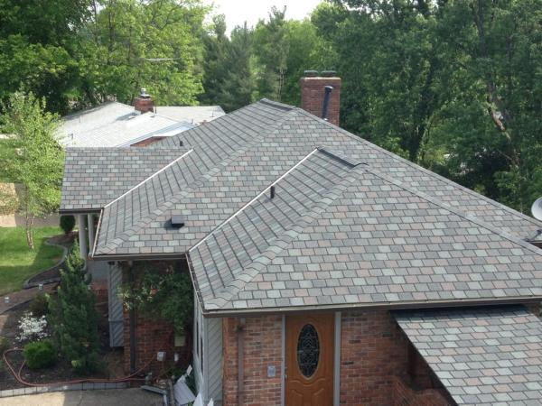 New grey shingles on residential property completed by Bowling Roofing.
