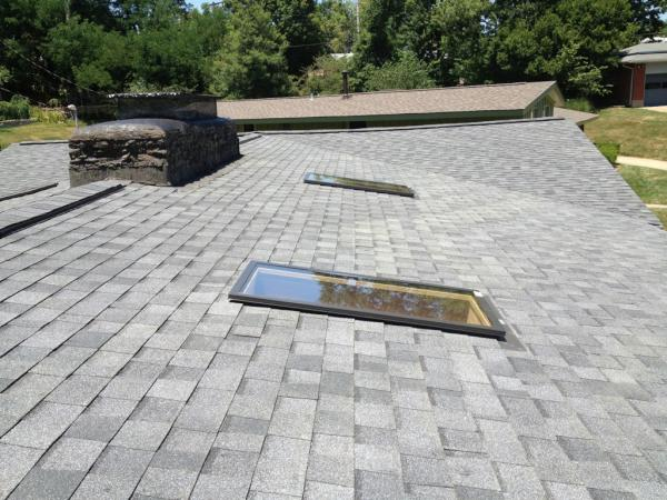 Two sunlights installed over beautiful grey shingles on a residential property completed by Bowling Roofing.