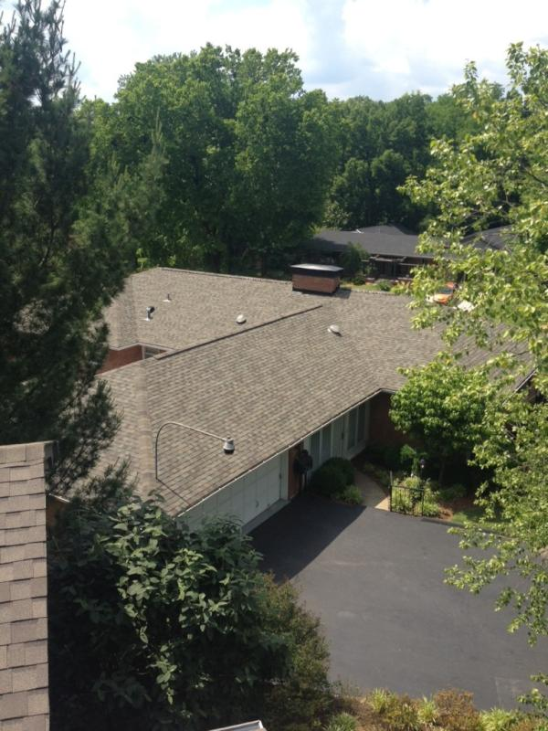 New brown shingles on a single story home done by Bowling Roofing.
