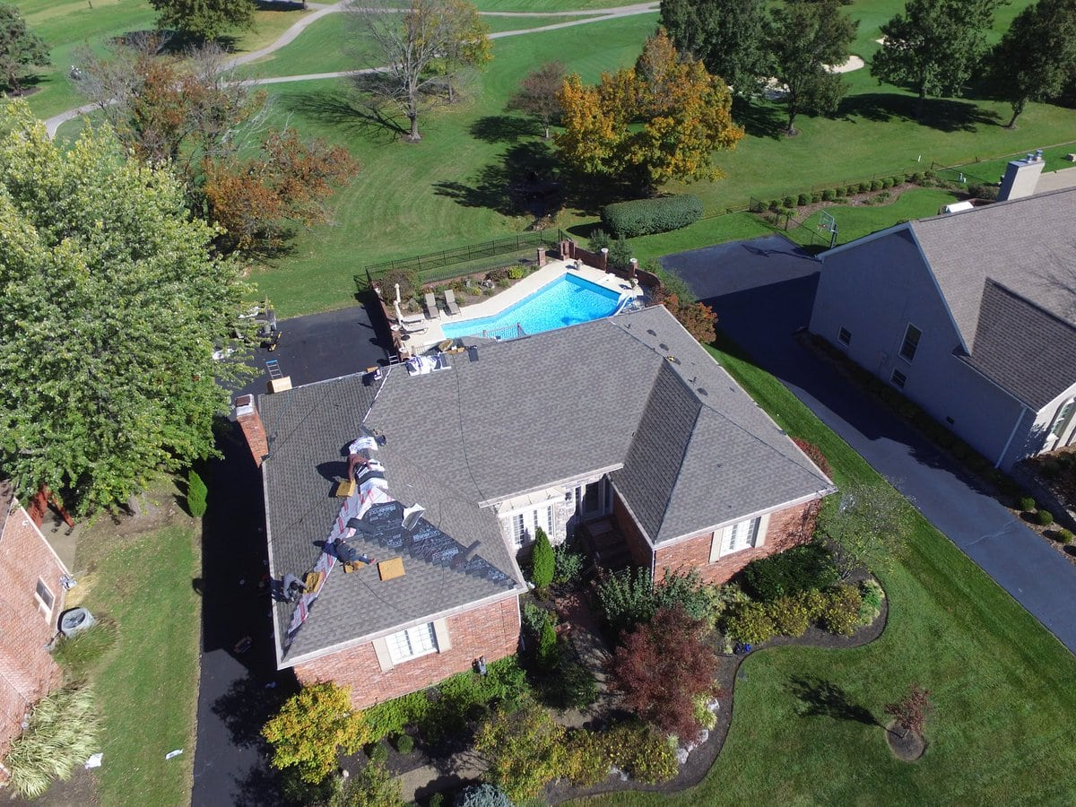 Drone photograph of the installation of new grey shingles near completion by Bowling Roofing