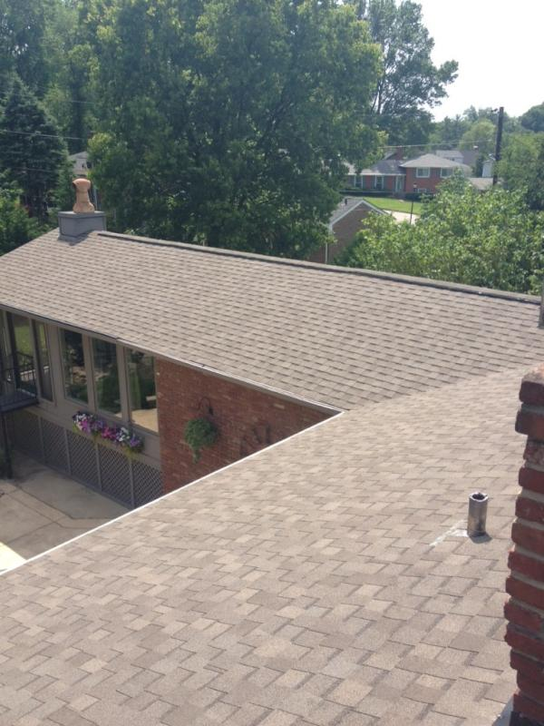 New brown shingled roof on a residential property, completed by Bowling Roofing.