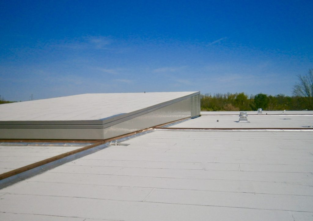 Modern, gorgeous white roof on a clear sunny day done by Bowling Roofing.